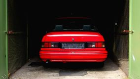 Red Car. Parking in inside a Garage stock images