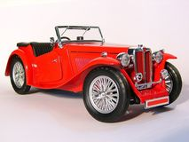Red Car. Old red car, MG Midget 1947, over white Stock Photo