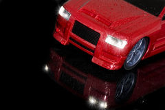 Red car. There is red sports car in black background Stock Photo