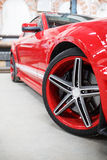 Red car with alloy wheel indoor Stock Image