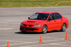 Red car during autocross event 1. Red autocross racer negotiating cones Stock Photo