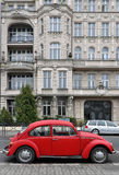 Red car background Beetle on white classic old building Stock Photo