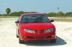 Red car on beach Stock Photos