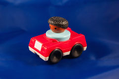 Red car black driver Royalty Free Stock Photo