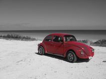 Red Car on Black & White Landscape. Cancun - Mexico Stock Photo