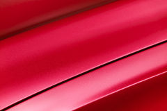 Red car bodywork. Fragment of red steel car bodywork, vehicle silver paint coating texture, selective focus, abstract Stock Photography