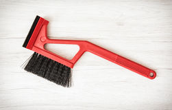 Red car brush with scraper Royalty Free Stock Photos