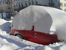 Red car buried in snow after blizzard  Stock Image