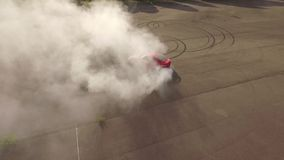 Red car burning tires stock video footage