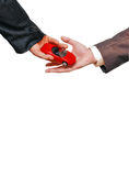 Red car in businessmen hands Stock Images