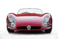 Red car cabrio Alfa Romeo 33 Stradale. Alfa Romeo 33 Stradale  is a mid-engined sports car built by Italian car manufacturer Alfa Romeo in 18 examples between Stock Photos