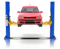Red car on the car lift Royalty Free Stock Photography
