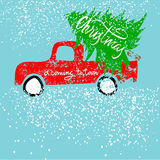 Red car carries Christmas spruce. Christmas is coming to town. Gold and White Lettering. Stock Images
