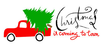 Red car carries Christmas spruce. Christmas is coming to town. Grunge handwritten lettering. Stock Photography
