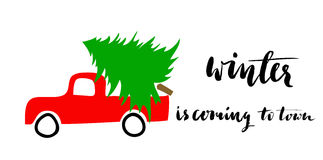 Red car carries Christmas spruce. Christmas is coming to town. Grunge handwritten lettering. Royalty Free Stock Photography