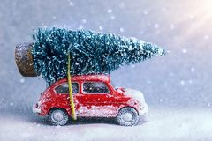 Red Car Carrying A Christmas Tree Stock Image