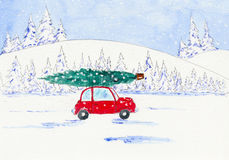 Red car with Christmas tree on top Stock Photo
