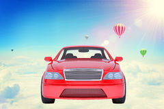 Red car on clouds Stock Photos