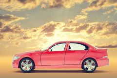 Red car. On colorful sky background, side view Stock Image