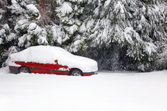 Red car covered in snow Stock Photos