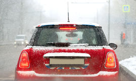 Red car covered with snow detail Stock Photos