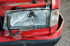 Red car crash - broken front light Royalty Free Stock Photography