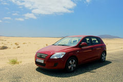Red car in desert Stock Photo