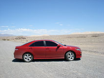 Red car in desert Royalty Free Stock Photography