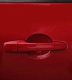 Red Car door handle stock image