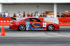 Red car drifting during qualifying session Royalty Free Stock Images
