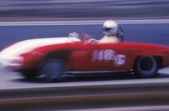 A red car and driver in the Laguna Seca Classic Car Race in Carmel, California Stock Photos