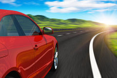 Red car driving by autobahn Royalty Free Stock Image