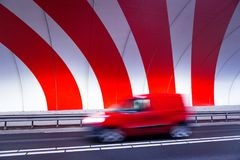 Fast driving car in tunnel with stripes Stock Images