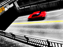 Red Car Driving on Road Royalty Free Stock Photography