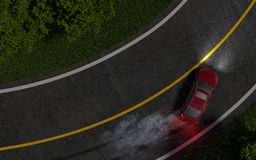 Red car enters the turn with skid. night.  Royalty Free Stock Photography
