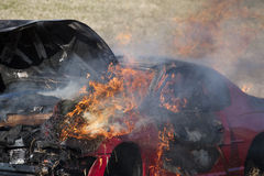 Red car on fire Royalty Free Stock Photo