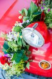 Red car with Flower Bouquet. Red wedding car with flower bouquet, detail view Royalty Free Stock Image