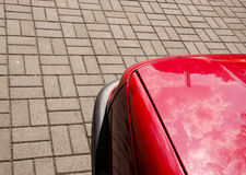 Red car fragment and pavement Royalty Free Stock Image
