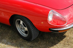 Red Car Front. Front end of red Alfa Romeo convertible car / automobile focusing on tire and headlamp stock images