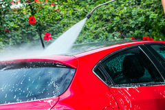 Red car getting a wash. With soap Stock Images