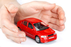Red car in hands Royalty Free Stock Photo