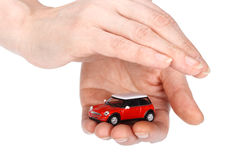 Red car in hands Stock Photo
