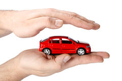 Red car in hands Stock Images