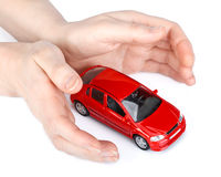 Red car in hands Stock Photos