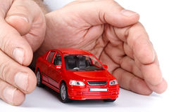 Red car in hands stock image