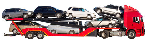 Red car hauler. Red double-decker car carrier isolated on white Royalty Free Stock Photos