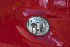 Red car headlight Royalty Free Stock Images