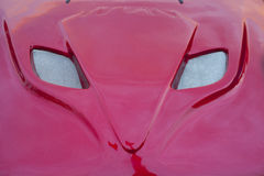 Red car hood shaped as a fox head Royalty Free Stock Photography