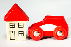 Red car and house Royalty Free Stock Photo