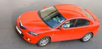 Red car isolated. On gray asphalt of my cars series Stock Photos
